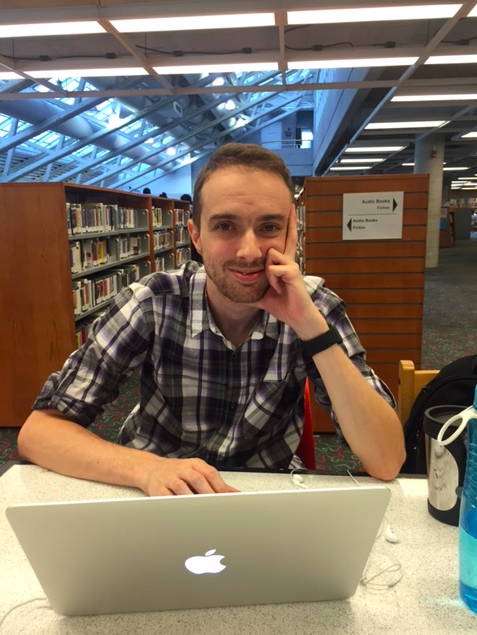 A photo of Jérôme working hard at the library to research new social enterprises for our directory.